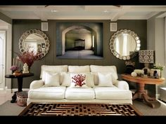 Design idea for living room. I dk what that is between the mirrors though ...