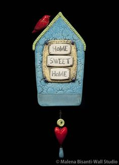 Home Sweet Home ceramic wall sculpture.  © Malena Bisanti-Wall. www.mbwstudio.com