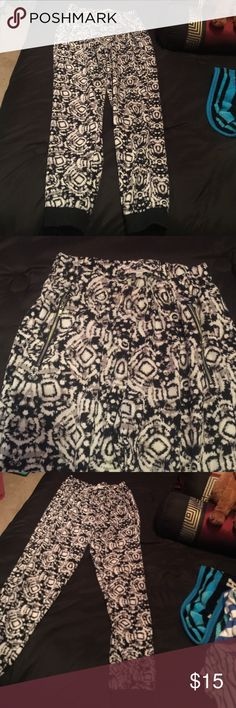 Black and White Joggers Gather at the waist and ankles. Has black and white designs and has zippers (but their not pockets). Pants Track Pants & Joggers