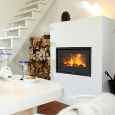 Rais 500-1: Super minimalist inset fire with a range of architectural possibilities. #kernowfires #wadebridge #redruth #cornwall #rais #fire #stove #wood #burner #modern #contemporary #inset