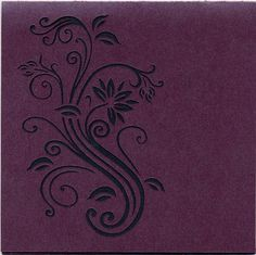 Cut Out detail on the front of a wedding invitation in a pearlized plum paper, the black pearlized paper peeks out from underneath.
