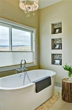 Modern Master Bath by Judith Balis: free standing tub, pebble floor, niche, glass tiles, chandelier, stump side table (photo by Tony Moody: http://www.moodyimages.com/)