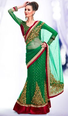 Flaunt the traditional beauty that you are, draping this green color embroidered net viscose lahenga sari. The ethnic lace, moti, resham and stones work with a attire adds a sign of splendor statement for your look. Upon request we can make round front/back neck and short 6 inches sleeves regular saree blouse also. #traditionallehengasaree #ethnicstylelehangasari #embroideredlehangasarees