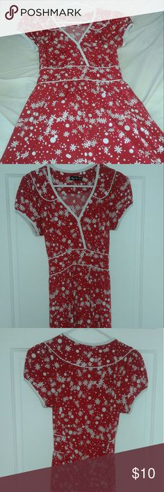 Red & white floral vintage inspired dress Short sleeve red dress with white flowers and dots. Sort of vintage inspired. Faux wrap front with sash that ties in back. Super comfy!! Worn only a few times -very good almost like new condition. Great for work, worn to a bridal shower and graduation event. Happy  to answer any questions! Ruby Rox Dresses Midi
