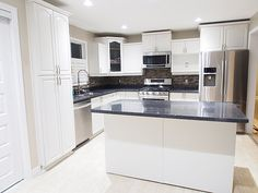 Kitchen refinishing and cabinet spraying painting oak to for Kitchen design zurich