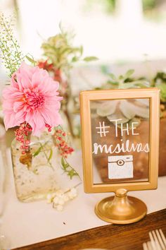 Use a Tolsby frame to display your Instagram hashtag…This frame was spray-painted gold and written on with a white paint pen.