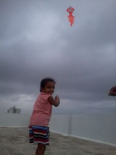 Smallest International Kite Flyers India - Mahi Pathak Enjoying Kite Flying in Rain - monsoon at 16 June 2013 - Ahmedabad.  please visit - http://www.kiteclubindia.in and http://www.indiakiteclub.com