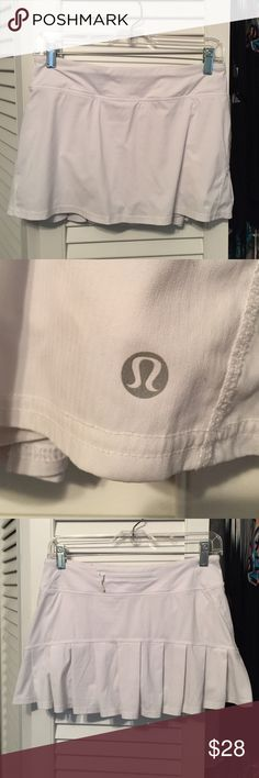 Lululemon Skirt White pleated Lulu skirt, slightly used, in good condition except a few tiny brown spots that are hardly noticeable! lululemon athletica Skirts