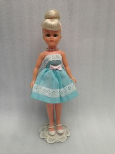 1963 Jill with beehive hairdo wearing  #60545 (1963) blue strapless gown with white lace and pink bow.  Matching Ginnette and Ginny outfits.  Collector's Encyclopedia of Vogue Dolls, Second Edition, page 274.  I would love to add a doll like this to my collection.  I remember the beehive hairdo very well!