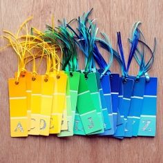 Make DIY letter bookmarks using paint chips and book pages.    These were made for a book-themed baby shower.