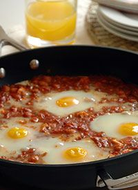 Eggs in Spicy Tomato Sauce with Chickpeas South African Recipes, Ethnic Recipes, Spicy Tomato Sauce, Recipe Search, Salad Dressings, Chickpeas, Menu, Eggs, Baking