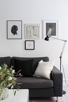 Living room. Dark grey sofa, picture wall