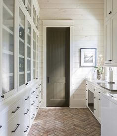 Brick Pavers in the Mudroom + Herringbone brick floors + Dark Olive Green Painted Door + Bleached Wood Shiplap Walls