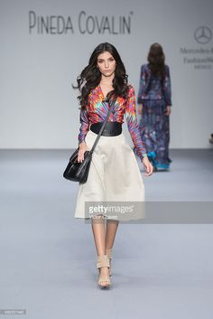 A model walks the runway during the Pineda Covalin show at Mercedes-Benz Fashion Week Mexico Spring/Summer 2016 at Campo Marte on October 13, 2015 in Mexico City, Mexico.