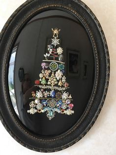 This is my jewelry Christmas tree that I made with special jewelry and put in an antique frame!