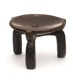 A certified antique from Tanzania, the Hehe stool is hand-carved from hardwood. This charming low stool is perfect as extra seating, a side table or even for tabletop display.