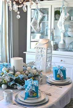 Deck the halls with blue, white, and silver to create a winter wonderland in your dining room. Details like frosted pine cones, glittered ornaments, and white stockings complete the look. #Partymostess #DIY #christmas #whitechristmas #christmastree