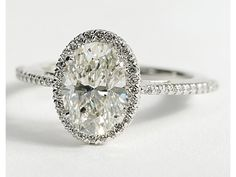 Oval Halo Diamond Engagement Ring in 14K White Gold | Blue Nile I love how dainty this band looks..so romantic