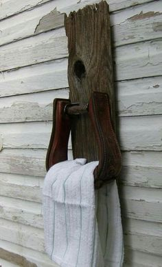 Stirrup towel holder