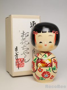 """This is Japanese Creative Kokeshi doll design by Katsuyukiu.   The tittle is Ohana-Chan, meaning Flower."""