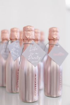 Rose gold champagne wedding favors. We're in love!