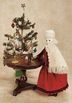 Marquetry Pedestal Table with German All-Bisque Doll and Holiday Trees Late 19th century