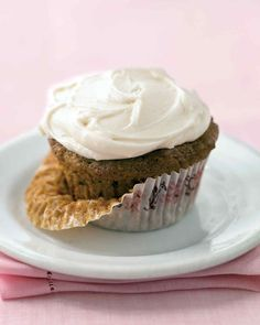 Sweet Zucchini Cupcakes | Martha Stewart Living - These moist zucchini cupcakes are sweetened with brown sugar and enhanced with cinnamon and chopped pecans or walnuts. Spread the cupcakes with cream cheese frosting for an irresistible summertime treat.