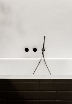 Fixtures by Naoto Fukasawa for Aboutwater, a collaboration between Boffi and Fantini, adorn the Villeroy & Boch tub.