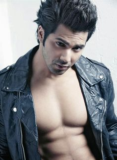 Varun Dhawan is ready to rock Bollywood with his upcoming film 'Main Tera Hero'. Bollywood Actors, Bollywood Celebrities, Varun Dhawan Body, Varun Dhawan Wallpaper, The Wicked The Divine, Alia And Varun, Black Leather Biker Jacket, Gay, Indian Star