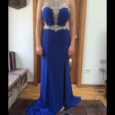 HP Prom Dress NWT Gorgeous Rachel Allan Flattering royal blue jersey dress with beaded high neckline and cinched waistline and side slit.  Featuring hand sewn silver sequins that embellish the upper bodice.  Never worn and no alterations made to dress! Rachel Allan Dresses