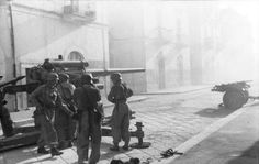 Germans with an 8.8 cm FlaK anti-tank gun in a town in Southern Italy, 8 November 1943.