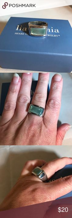 LIA SOPHIA SILVER AND BLUE RING. Size 7. Pretty! The blue looks like the ocean blue. LIA SOPHIA.  Size 7  Excellent condition!   BUNDLE TO SAVE 💲💲👜🛍 2+ items Lia Sophia Jewelry Rings