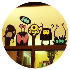 Have you got lonely blank windows? Make a gang of paper monsters to hang out on…
