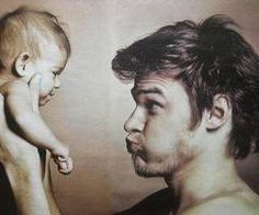father and baby fun portrait
