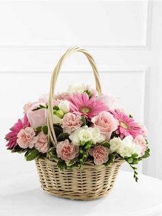 Pink and white bereavement basket. Enduring Peace Basket Deluxe. FTD S47-4553D