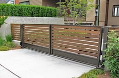 Modern, double swinging wood gate. Gate was painted bronze to match the existing…