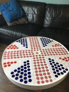 Hi, my first table simply called the patriotic one! Top is beer bottle tops and clear resin! of the price will go to mind charity! I started making stuff because it's goid for my soul Bottle Top Tables, Tapas, Bowling Ball, Golf Ball, Cable Reel, Frat Coolers, Kitchen Stools, Mosaic Projects, Clear Resin
