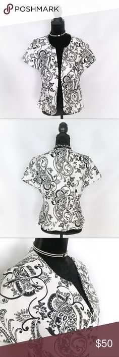 WHBM Short Sleeve Floral Textured Jacket Great short sleeve printed blazer from White House Black Market. Excellent Used Condition. Size 14. Small pockets in the front. Ruffled Hem. Large Fish and eye hooks. Size 14. Fully Lined. White House Black Market Jackets & Coats