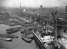 Barges waiting for access to Regents Canal from Regents Canal Dock, viewed from one of two new electric coal dischargers erected at the dock at Limehouse Getty Images Old London, East London, Vintage Photographs, Vintage Photos, London Docklands, Regents Canal, Steampunk, Fine Art Prints, Canvas Prints
