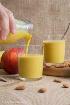 Turmeric, nectarine & banana smoothie, a healthy  & nutritious vegan drink rich in vitamins & antioxidants.