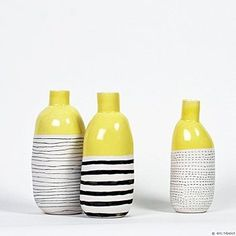 Yellow, black and white vases