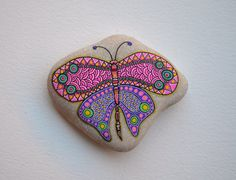 Hand painted butterfly on a pebble rock https://www.facebook.com/ISassiDelladriatico