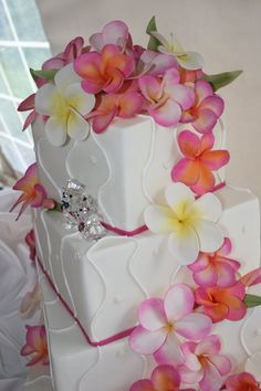 Inspired by the fragrant Hawaiian blossoms, these handmade sugar frangipani cascade in a graceful swirl of hot tropical colors.