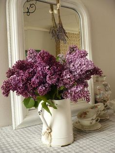 I love my lilacs, wish they bloomed longer. I love the look of this vase and everything in the pic.
