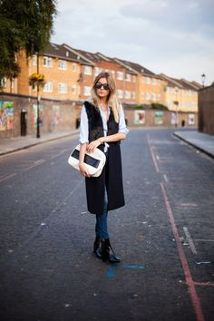 sleeveless coat street style