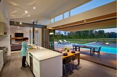 Might as well just get a pool enclosure ;) - Kitchen walls that lift up to reveal the swimming pool.