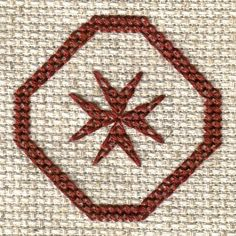 Free Cross Motif Patterns - Cross Stitch and Back Stitch Charts: Stitched Model of Free Maltese Cross Counted Cross Stitch Pattern