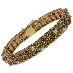 CARTIER Gold, Ruby and Diamond Strap Bracelet