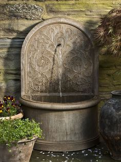 Corsini Wall Fountain, the perfect cast stone water fountain with Arabesque design!