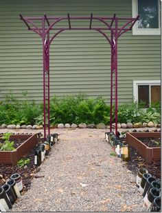 How to rescue a rusted out wrought iron arbor; reusing what you have and making it fab in the garden.
